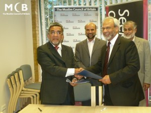 2011 - Signing MoU with Malaysian Minister of Religious Affairs